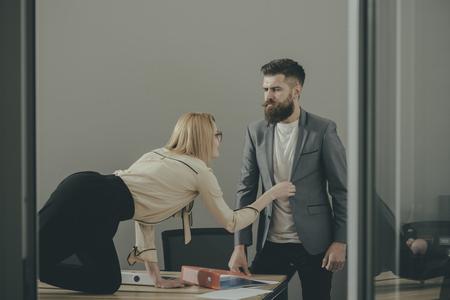 Photo pour Young blond secretary seducing rich businessman in office - image libre de droit