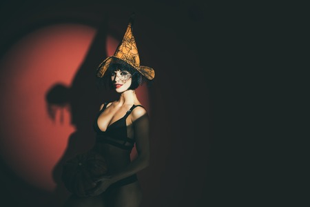 Foto de Sexy stripper Woman with pumpkins. Halloween lingerie model. Vampire girls. Sunsual desire concept. - Imagen libre de derechos