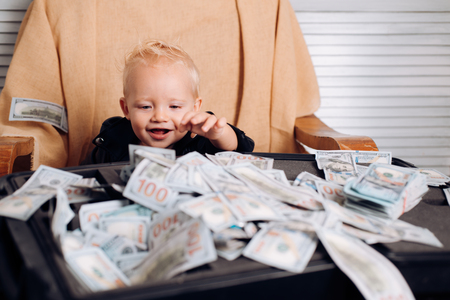 Foto de Little boy count money in cash. Little entrepreneur work in office - Imagen libre de derechos