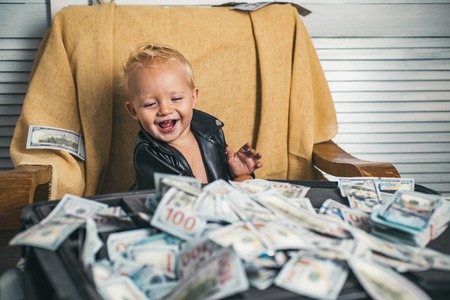 Foto de Good deal. Small child do business accounting in startup company. Little entrepreneur work in office. Boy child with money case. Little boy count money in cash. Startup business costs - Imagen libre de derechos