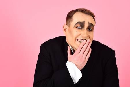 Photo for Laughing face. Comedian performer giggling. Mime artist. Mime with face paint. Man with mime makeup. Theatre actor miming. Stage actor miming. Theatrical performance art and pantomime. Comedy. - Royalty Free Image