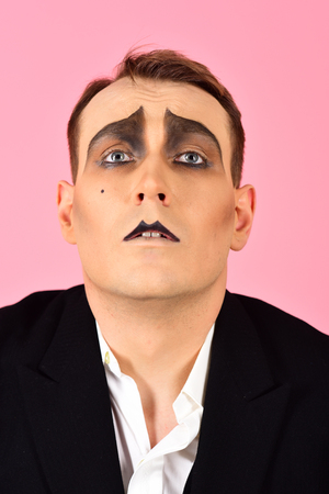 Photo for Skill at improvisation. Mime artist. Mime with face paint. Man with mime makeup. Theatre actor miming. Stage actor miming. Theatrical performance art and pantomime. Comedian or tragedian performer. - Royalty Free Image