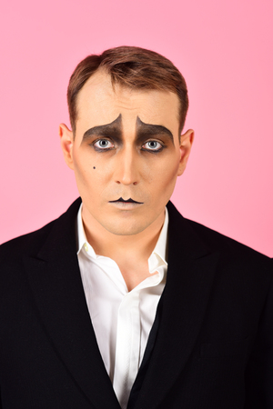 Photo for He is much of an actor. Mime with face paint. Mime artist. Man with mime makeup. Theatre actor miming. Stage actor miming. Theatrical performance art and pantomime. Comedian or tragedian performer. - Royalty Free Image