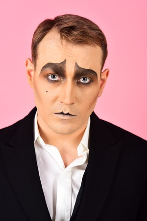 Photo for Tragical actor. Man with mime makeup. Mime artist. Mime with face paint. Theatre actor miming. Stage actor miming. Theatrical performance art and pantomime. Comedian or tragedian performer. - Royalty Free Image