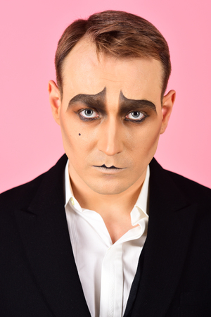 Photo for Performing drama. Theatre actor miming. Mime artist. Mime with face paint. Man with mime makeup. Stage actor miming. Theatrical performance art and pantomime. Comedian or tragedian performer. - Royalty Free Image