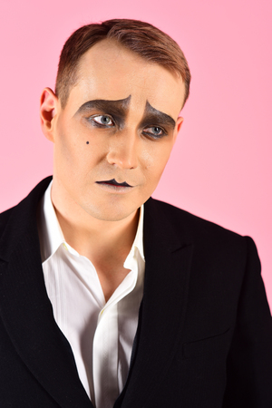 Photo for He is made to be an actor. Man with mime makeup. Mime with face paint. Mime artist. Theatre actor miming. Stage actor playing. Theatrical performance art and pantomime. Tragedian performer. Tragedy. - Royalty Free Image