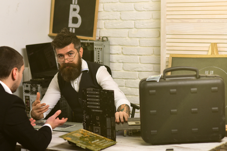 Photo for Accepting Bitcoin today will make your business ready for tomorrow. Businessmen in office with bitcoin symbol. Bearded man and customer negotiate a deal. Company manager and man have business meeting. - Royalty Free Image