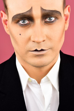 Photo for Sad face. Mime artist. Comedian or tragedian performer. Mime with face paint. Man with mime makeup. Theatre actor miming. Stage actor miming. Theatrical performance art and pantomime. - Royalty Free Image