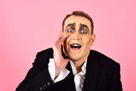 Photo for Secretly between you and me. Performance art and pantomime. Actor acting secret. Mime artist. Mime with face paint. Man with mime makeup. Theatre actor miming. Comedian or tragedian performer. - Royalty Free Image