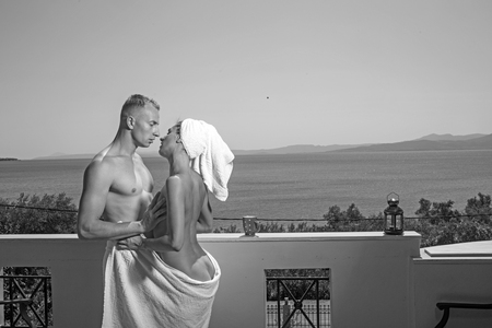 Photo pour Summer holidays and paradise travel vacation. Love relations of naked couple after shower. Couple in love with sexy body relax on balcony. Sexy woman and man in morning. Family and valentines day. - image libre de droit
