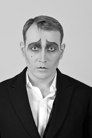 Photo for He is much of an actor. Mime with face paint. Mime artist. Man with mime makeup. Theatre actor miming. Stage actor miming. Theatrical performance art and pantomime. Comedian or tragedian performer - Royalty Free Image
