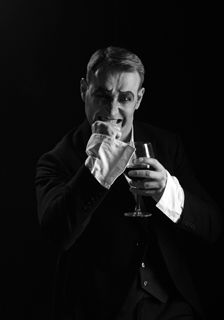 Photo for Improvisation. Mime artist perform on stage. Stage actor pantomime drinking wine. Comedian with mime makeup hold wine glass. Drama theatre actor miming. Theatrical performance art and silen comedy - Royalty Free Image