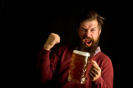 Foto de Brewery concept. Happy smiling man with beer. Senior man drinking beer with surprise face. Happy brewer. Beer in the UK. - Imagen libre de derechos