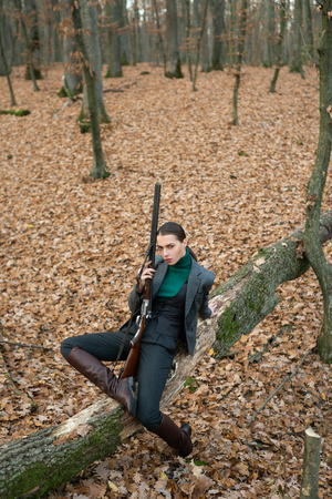 Photo for successful hunt. hunting sport. female hunter in forest. woman with weapon. Target shot. girl with rifle. chase hunting. Gun shop. military fashion. achievements of goals. hunting nature environment - Royalty Free Image
