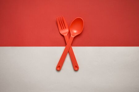Photo for Red fork and spoon crossed over Indonesian flag - Royalty Free Image