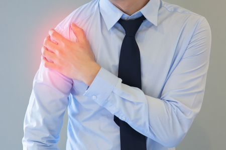 Photo pour Man having shoulder pain problem with red spot - image libre de droit