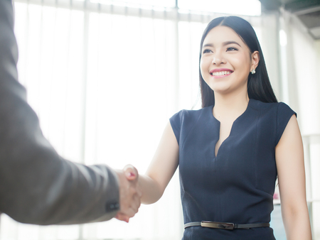 Photo for Smart and confident Asian businesswoman smiling and shaking hands - Royalty Free Image