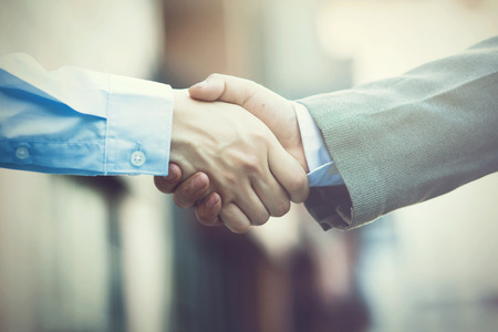 Foto de Business handshake. Two businessman shaking hands (Vintage tone) - Imagen libre de derechos