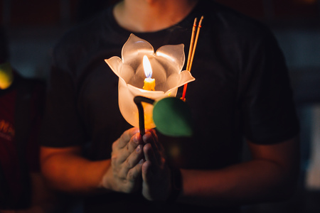 Photo for Buddhist praying with incense sticks, lotus flower and candles on holy religion day of Vesak at night - Royalty Free Image