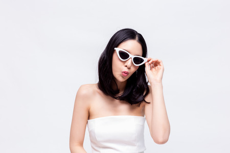 Photo pour Elegant and attractive Asian chic fashion woman in stylish white dress with sunglasses in isolated background - image libre de droit