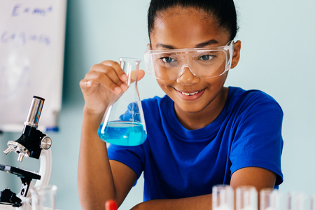 Photo pour Young African American kid test chemistry lab experiment and shake glass tube flask with microscope and smile - science and learning education concept - image libre de droit