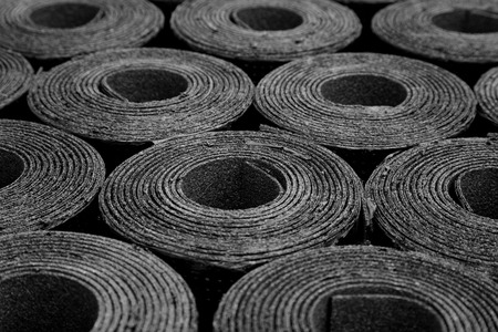 Photo for Closeup of Rolls of new black roofing felt or bitumen - Royalty Free Image