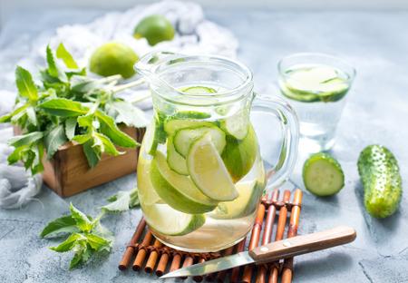 Foto de drink with lemon and cucumber in the jug - Imagen libre de derechos