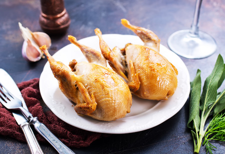 Photo for fried quail with spice on plate and on a table - Royalty Free Image