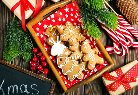 Photo for christmas cookies on a table, ginger cookies - Royalty Free Image