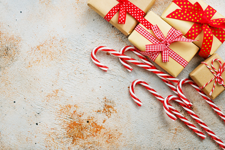 Photo for box for present and candy canes on a table - Royalty Free Image