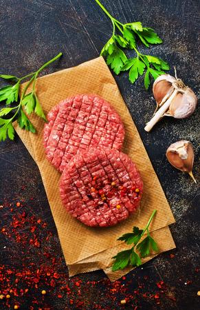 Foto de raw cutlets for burger with salt and aroma spice - Imagen libre de derechos