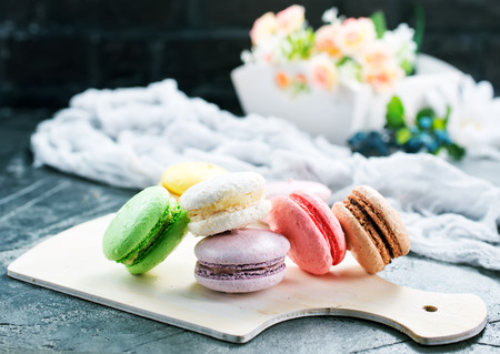 Photo pour color macaroons on board and on a table - image libre de droit