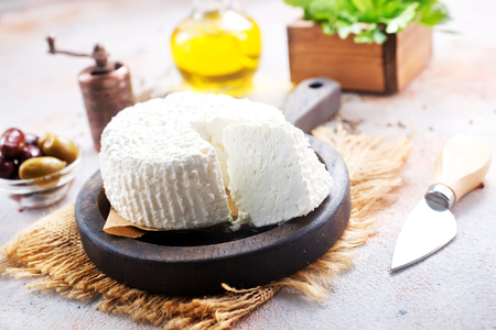 Photo pour cheese on board and on a table - image libre de droit