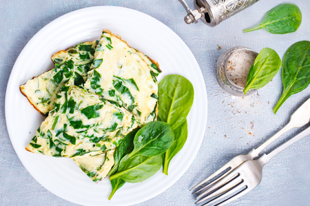 Photo for Omelette with spinach on plate, egg omelette - Royalty Free Image