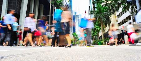 Photo pour Unidentified businessmen crossing the street in Singapore. There are more than 7,000 multinational corporations from US States, Japan and Europe in Singapore  - image libre de droit