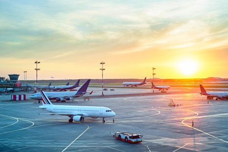 Photo for Airport with many airplanes at beautiful sunset - Royalty Free Image