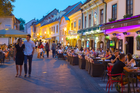 Photo for ZAGREB, CROATIA - AUG 25, 2017: Locals and tourists having a dinner at restaurants at Ivana Racica street. Zagreb is a capital and famous tourist destination in Croatia - Royalty Free Image