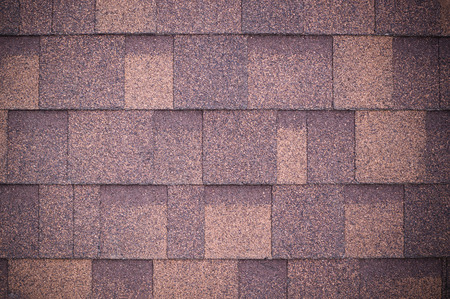 Foto de roof of new brown shingles background and texture. vignette - Imagen libre de derechos