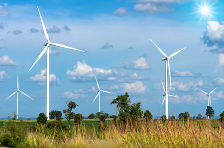 Photo for Wind turbine power generator on blue sky - Royalty Free Image
