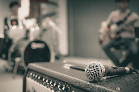 Photo for Closeup of microphone on musician blurred background - Royalty Free Image