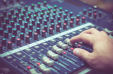 Photo for Hand adjusting audio mixer - Royalty Free Image