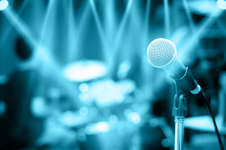 Photo for Close up of microphone on musician blurred background - Royalty Free Image