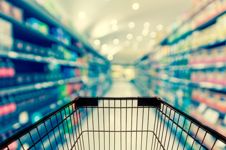 Foto de Abstract blurred photo of store with trolley in department store bokeh background - Imagen libre de derechos