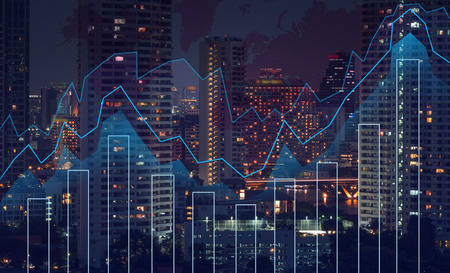 Foto de Trading graph on the cityscape at night and world map background,Business financial concept - Imagen libre de derechos