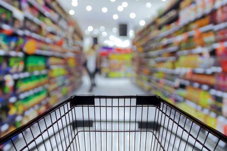 Foto de Abstract blurred photo of store with trolley in department store bokeh background - Imagen libre de derechos