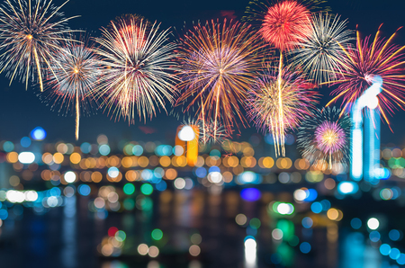 Photo pour Fantastic festive new years colorful fireworks on cityscape blurred photo bokeh in celebration night - image libre de droit