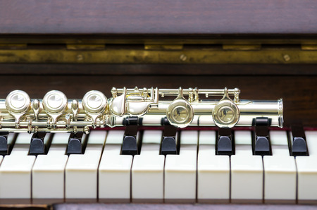 Photo for Closeup Flute on the keyboard of piano, musical instrument - Royalty Free Image