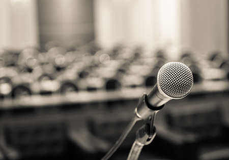 Photo for Microphone over the Abstract blurred photo of conference hall or seminar room background - Royalty Free Image