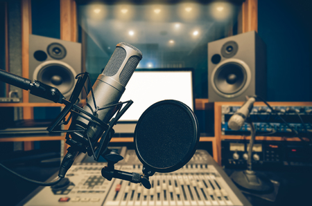 Photo for Professional condenser studio microphone over the abstract photo blurred of music studio background, Musical instrument Concept - Royalty Free Image
