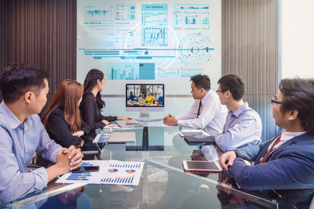 Photo pour Group of asian Business team having video conference with their manager via monitor display in the modern conference room, Business people meeting concept - image libre de droit